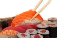 Sushi con los palillos Imagen de archivo