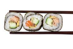 Sushi con los palillos Foto de archivo