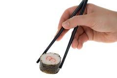 Sushi con los palillos de la tajada Fotografía de archivo libre de regalías