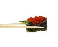Sushi con los palillos tirados en blanco Fotos de archivo libres de regalías