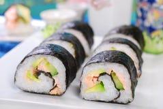 Sushi con los salmones y el aguacate Fotografía de archivo