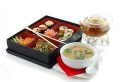 Sushi con té y sopa Imagenes de archivo