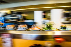 Sushi on conveyor belt Royalty Free Stock Photos