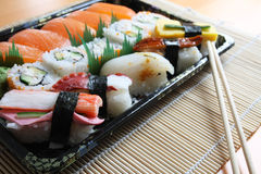 Sushi Cuisine. A collection of sushi on a bamboo mat stock photography