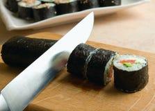 Sushi cutting Stock Photo