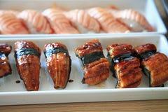 Sushi d'anguille et de saumons Photos stock