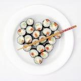 Sushi d'une plaque sous forme de coeur Photos stock