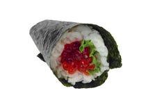 Sushi de color salmón del rodillo de la mano de las huevas Foto de archivo libre de regalías