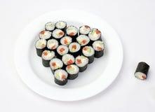 Sushi de plaque sous forme de coeur Photographie stock