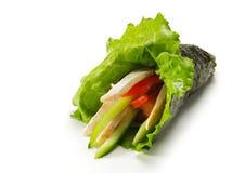 Sushi de roulis de main photo stock