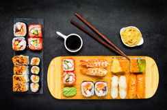 Sushi Delicacy with Soy Sauce, Wasabi and Sashimi Royalty Free Stock Photo