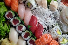 Sushi delight. This is a close up view of a Japanese dish including several pieces of sushi Royalty Free Stock Images