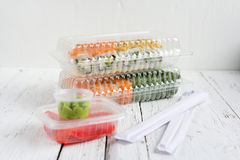 Sushi delivery set packaging with wasabi and ginger. On a white background Stock Image