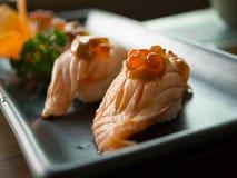 Sushi di color salmone cotti Fotografia Stock