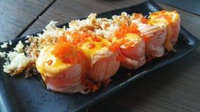 Sushi di color salmone del rotolo Fotografie Stock