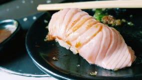 Sushi di color salmone della griglia Immagine Stock