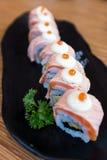Sushi di color salmone Rolls Fotografie Stock