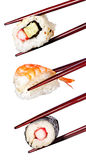 Sushi di Nigiri con i bastoncini isolati su un fondo bianco Fotografia Stock