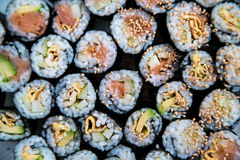 Sushi - Different kinds prepared on the plate. A number of sushi rolls prepared on a plate Royalty Free Stock Images