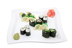 Sushi different nations. Neatly on a platter lined with sushi Royalty Free Stock Photo