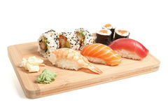 Sushi. Different type of sushi on a wooden plate stock photos