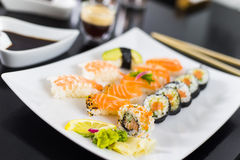 Sushi Dinner. With seaweed salad and wasabi royalty free stock image
