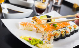 Sushi Dinner. With seaweed salad and wasabi royalty free stock photography
