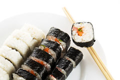 Sushi dish with chopsticks isolated on white Stock Photo
