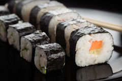Sushi rolls on black dish Royalty Free Stock Photo