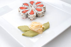 Sushi dish nicely decorated. Sushi nicely decorated forming hearts  shapes on white square dish Royalty Free Stock Images