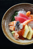 Sushi don , raw salmon tuna octopus and egg on rice Stock Images