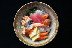 Sushi don , raw salmon tuna octopus and egg on rice Stock Photography