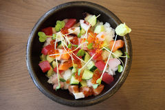 Sushi don , raw salmon tuna octopus on rice Royalty Free Stock Images