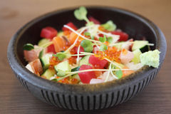 Sushi don , raw salmon tuna octopus on rice Royalty Free Stock Photo