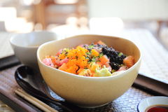 Sushi don , raw salmon tuna octopus on rice Stock Photo
