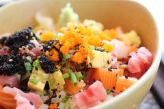 Sushi don , raw salmon tuna octopus on rice Stock Photos