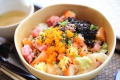 Sushi don , raw salmon tuna octopus on rice Stock Image