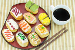 Sushi doughnut with coffee Stock Photography