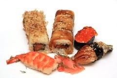 Sushi e battitori Immagini Stock