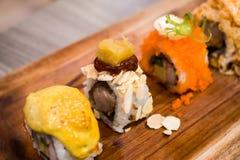 Sushi e dado della carne di maiale immagine stock