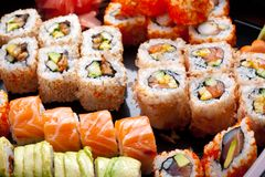 Sushi e rolos Fotografia de Stock Royalty Free