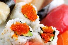 Sushi e rolos de Califórnia Imagem de Stock