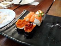 Sushi on earthenware. Royalty Free Stock Image