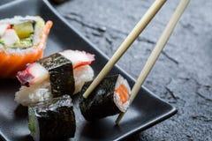 Sushi eaten with chopsticks Royalty Free Stock Photo