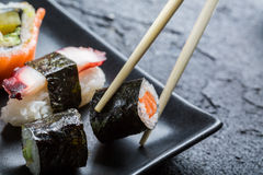 Sushi eaten with chopsticks Royalty Free Stock Images
