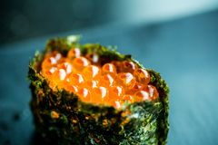 Sushi egg salmon wrap. Japanese food for healthy.egg salmon wrap sushi, premium sushi menu. Image for background and menu list. Salmon eggs or Ikura in Royalty Free Stock Photos