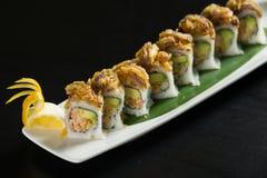 Sushi em uma placa branca Fotos de Stock