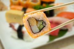 Sushi en palillos Imagen de archivo