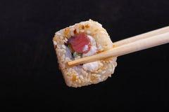 Sushi en un negro Fotografía de archivo libre de regalías