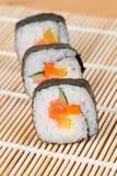 Sushi en una fila Imágenes de archivo libres de regalías